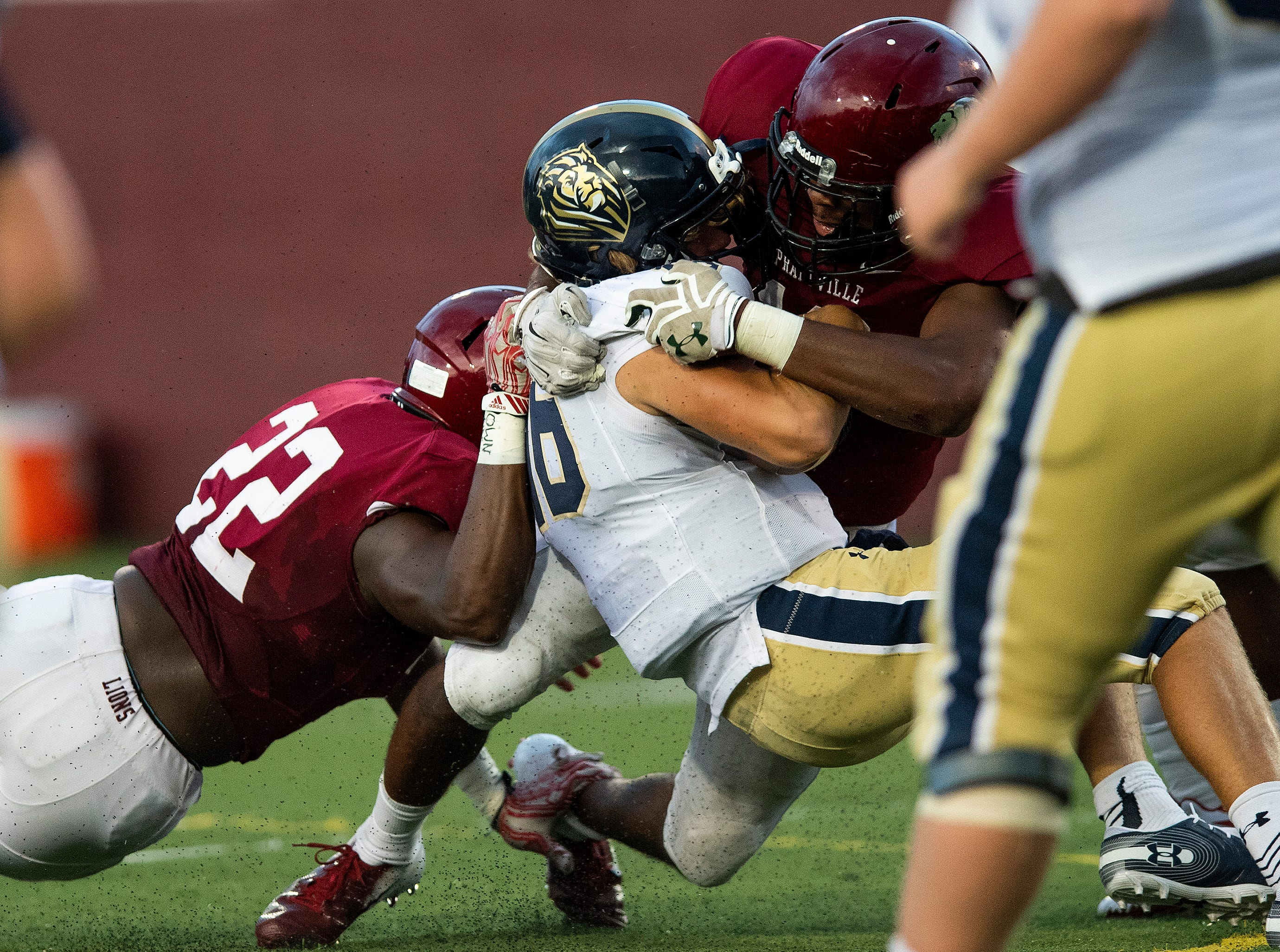 Prattville's Jacob Howard (10) and Willie Willis (22) stop  Foley's Clint White. at Stanley-Jensen Stadium in Prattville, Ala., on Friday August 24, 2018.