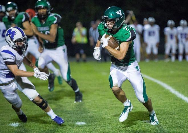 Yorktown's Austin Hill runs against Central on Friday at Yorktown High School. Yorktown won the game 26-20.