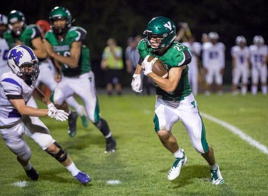 Yorktown's Austin Hill runs against Central in Yorktown's home opener on Friday at Yorktown High School. Yorktown won the game 26-20.