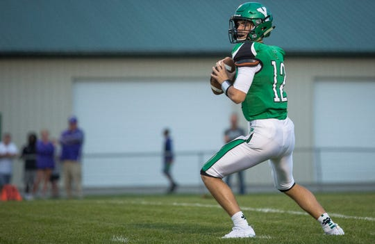 Yorktown's quarterback Reid Neal looks for an opening to pass during a game against Central in 2018. Yorktown won the game 26-20.