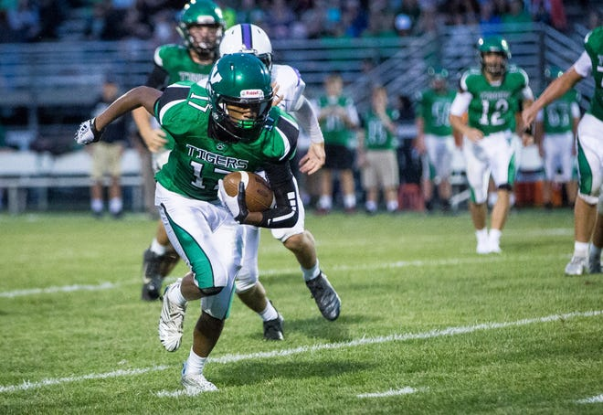 Yorktown's wide receiver MiLon McCowan breaks past Central's defense for a run Friday night during the game against Central. Yorktown won the game 26-20.