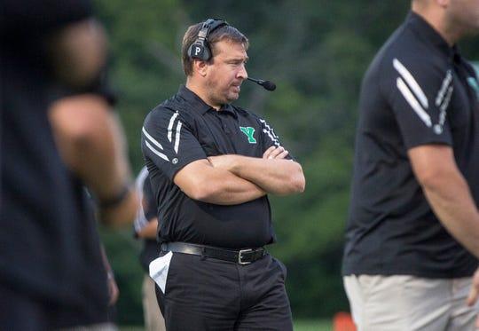 Yorktown's Mike Wilhelm coaches against Central in 2018 at Yorktown High School. Yorktown won the game 26-20.