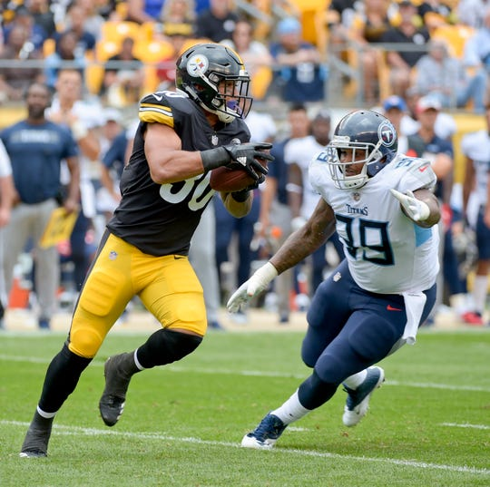 Pittsburgh Steelers running back James Conner (30) runs past Tennessee Titans defensive tackle Jurrell Casey (99) in the first quarter of an NFL football game against the Pittsburgh Steelers, Saturday, Aug. 25, 2018, in Pittsburgh. (AP Photo/Fred Vuich)