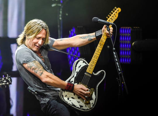 Keith Urban performs at Bridgestone Arena in Nashville, Tenn., Friday, Aug. 24, 2018.