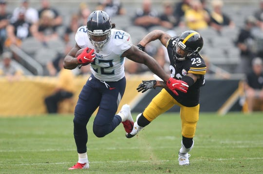 Aug 25, 2018; Pittsburgh, PA, USA;  Tennessee Titans running back Derrick Henry (22) runs after a catch as Pittsburgh Steelers defensive back Joe Haden (23) chases during the first quarter at Heinz Field. Mandatory Credit: Charles LeClaire-USA TODAY Sports