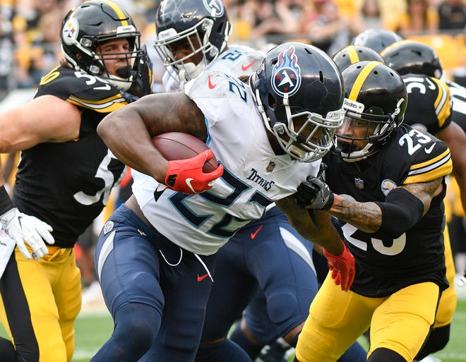 Tennessee Titans running back Derrick Henry (22) runs the ball as Pittsburgh Steelers defensive back Joe Haden (23) and linebacker Anthony Chickillo, left, pursue in the first quarter of an NFL football game, Saturday, Aug. 25, 2018, in Pittsburgh. (AP Photo/Don Wright)