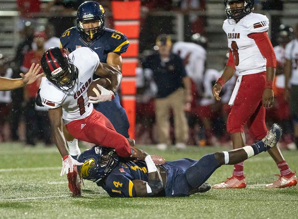 Arquel Smith of Naples tackles Ghana Oboh of Miami-Edison during the game at Naples High Friday night, August 24, 2018.