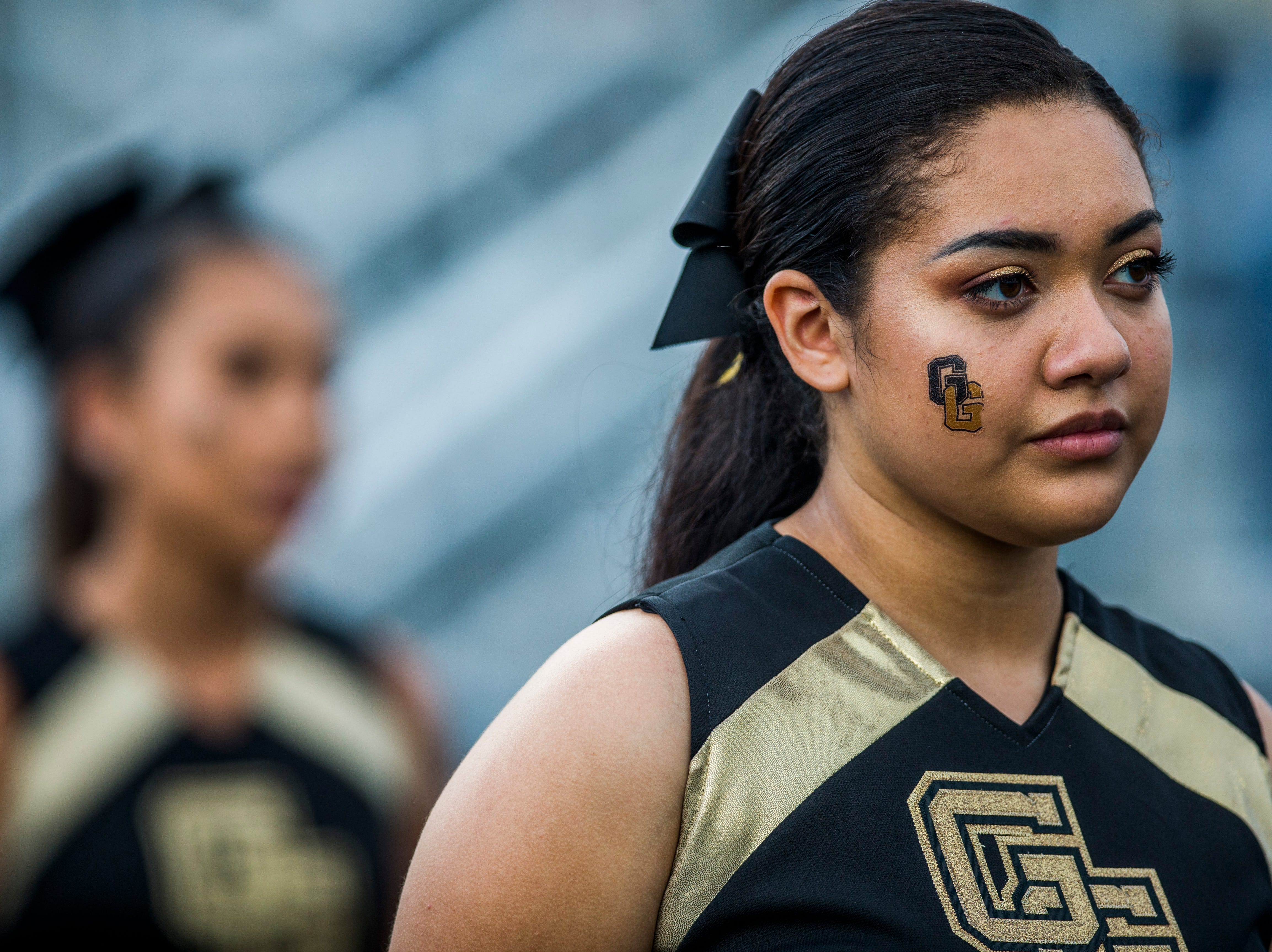 Golden Gate cheerleaders watch from the sidelines during the game against Immokalee at Golden Gate High School on Friday, Aug. 24, 2018.