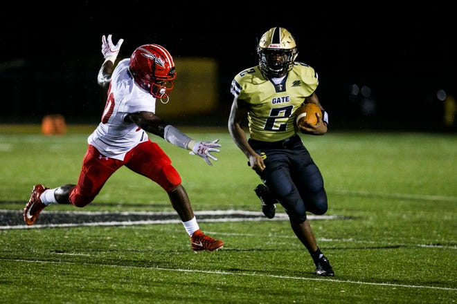 Golden Gate senior running back Jouvensly Bazile runs the ball during the game against Immokalee at Golden Gate High School on Friday, Aug. 24, 2018.