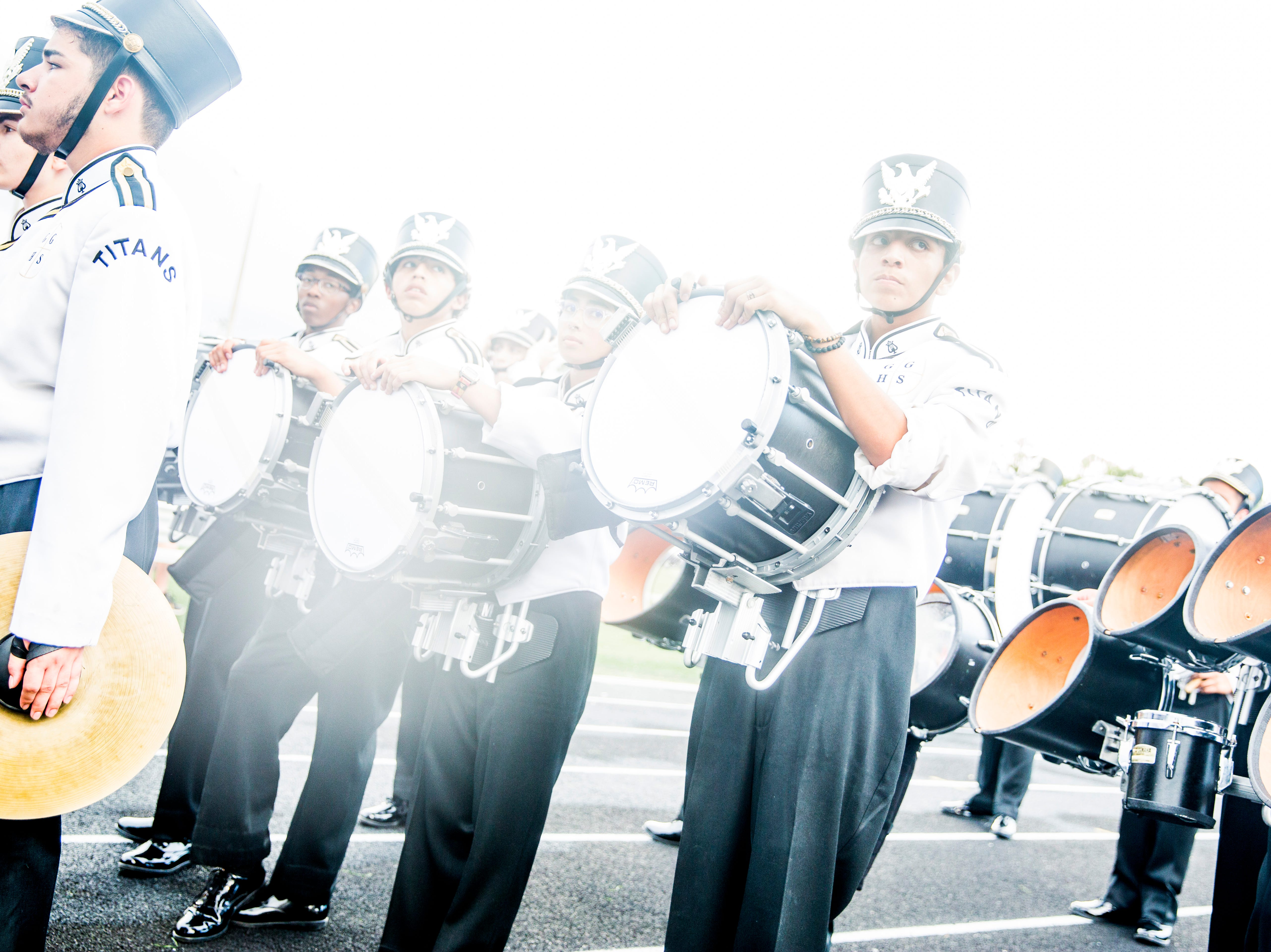Golden Gate marching band members leave the field before the game against Immokalee at Golden Gate High School on Friday, Aug. 24, 2018.