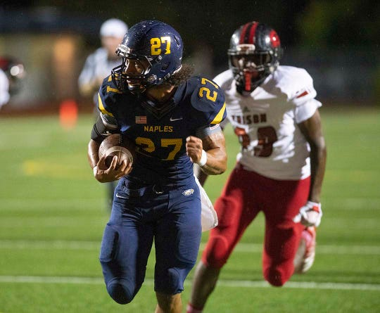 Chez Mellusi of Naples runs for a touchdown during the game against Miami-Edison at Naples High Friday night, August 24, 2018.