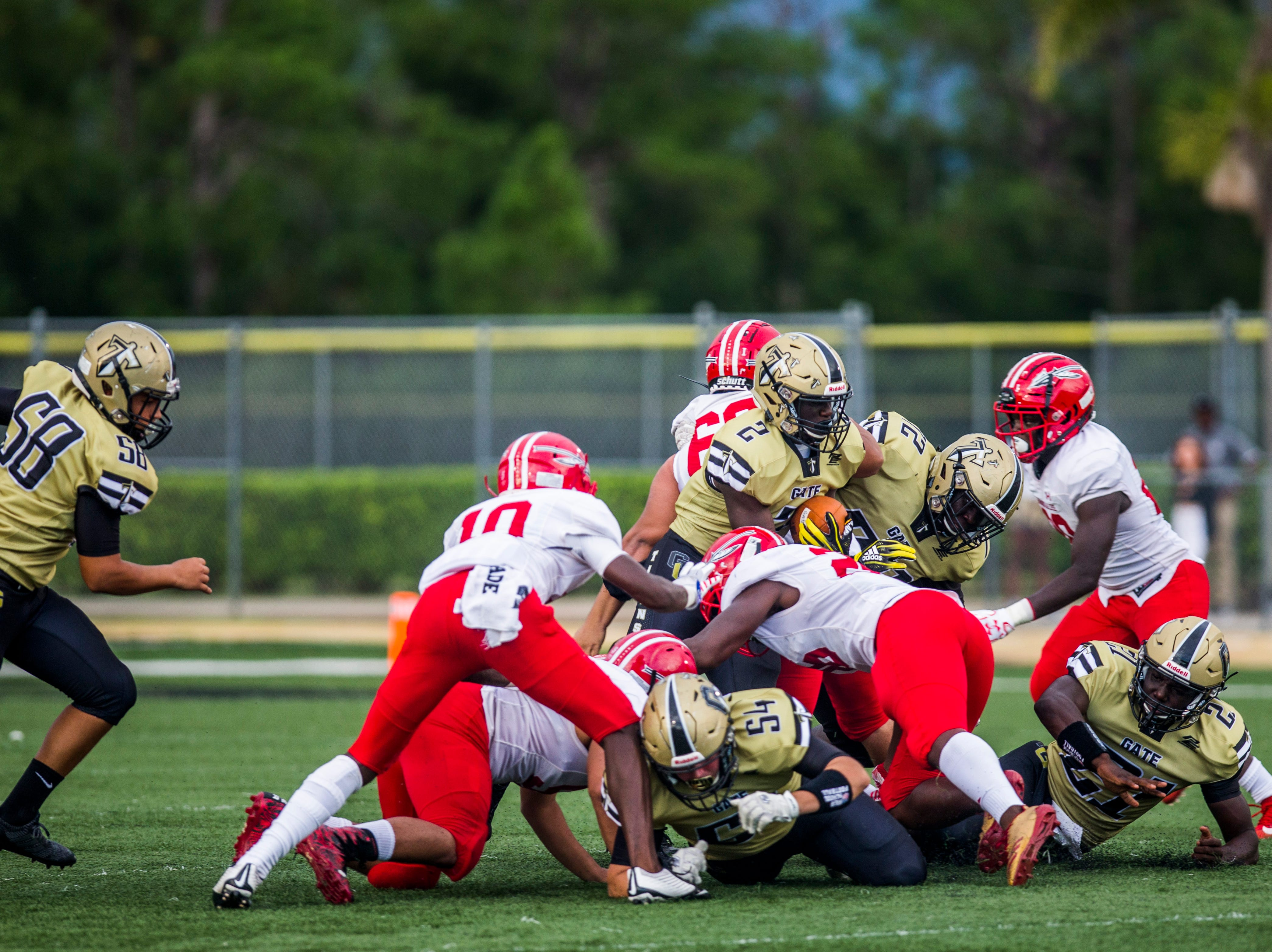 Golden Gate is brought down during the game against Immokalee at Golden Gate High School on Friday, Aug. 24, 2018.
