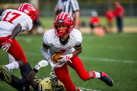 Immokalee runs the ball during the game against Gate High School on Friday, Aug. 24, 2018.