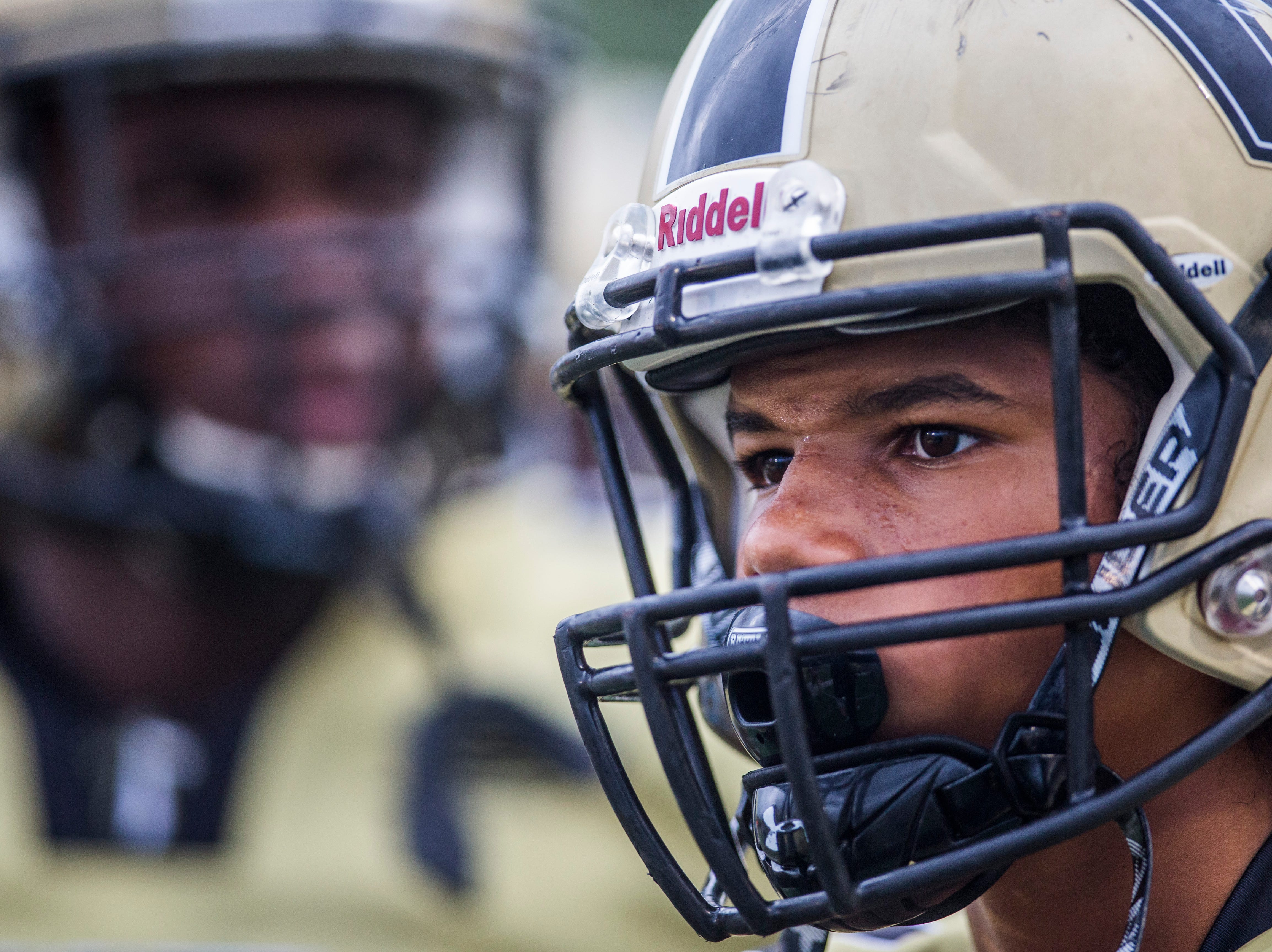 Golden Gate players watch from the sidelines during the game against Immokalee at Golden Gate High School on Friday, Aug. 24, 2018.
