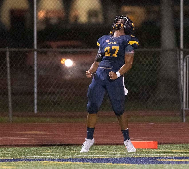 Chez Mellusi of Naples lets out a celebration yell after scoring a touchdown against Miami-Edison during the game at Naples High Friday night, August 24, 2018.
