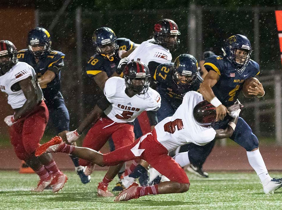 Elan Sommala of Naples ris tackled by Levan Jones of Miami-Edison during the game at Naples High Friday night, August 24, 2018.