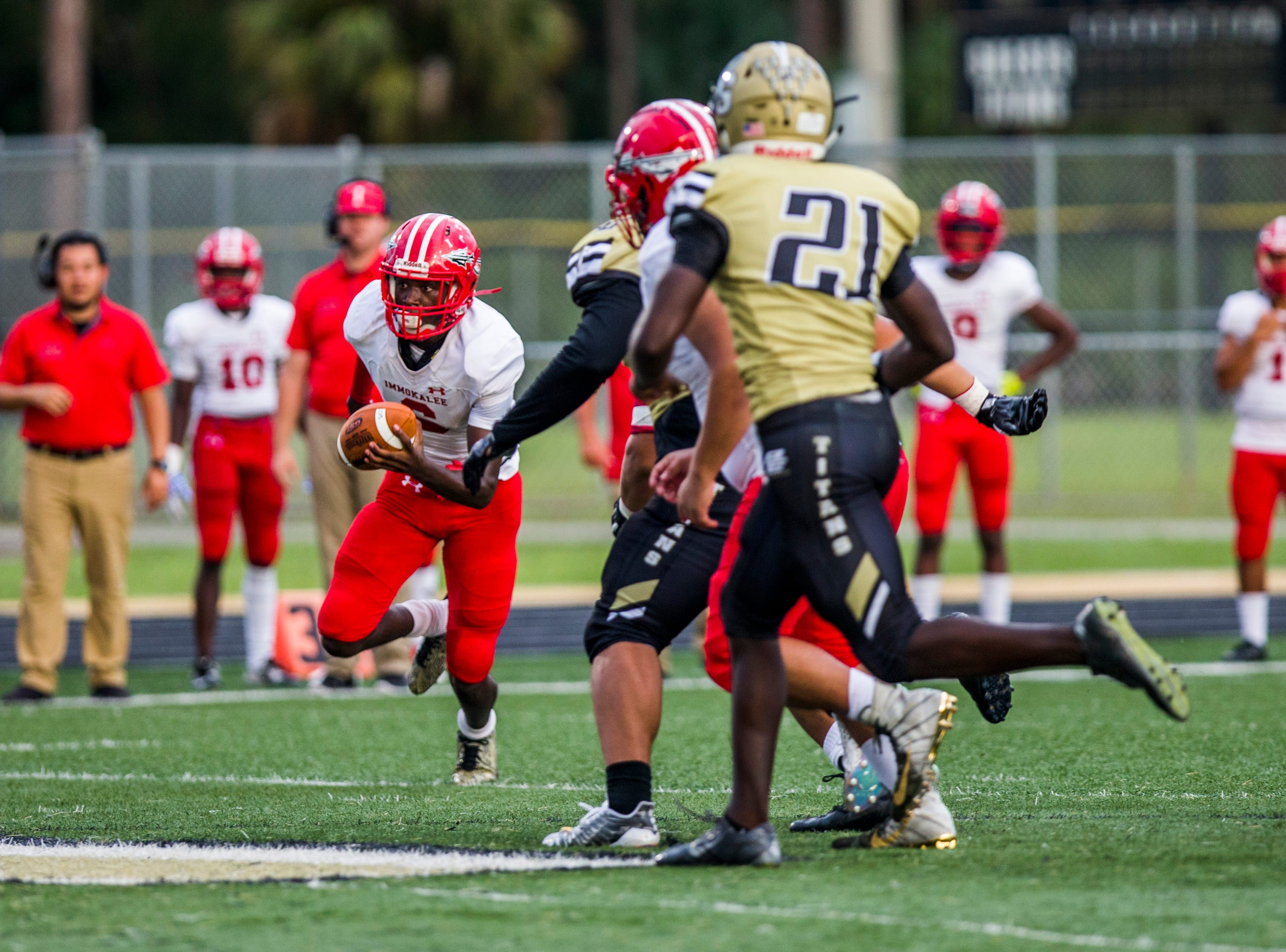 Immokalee wide receiver Joseph Elischama runs the ball during the game against Golden Gate at Golden Gate High School on Friday, Aug. 24, 2018.