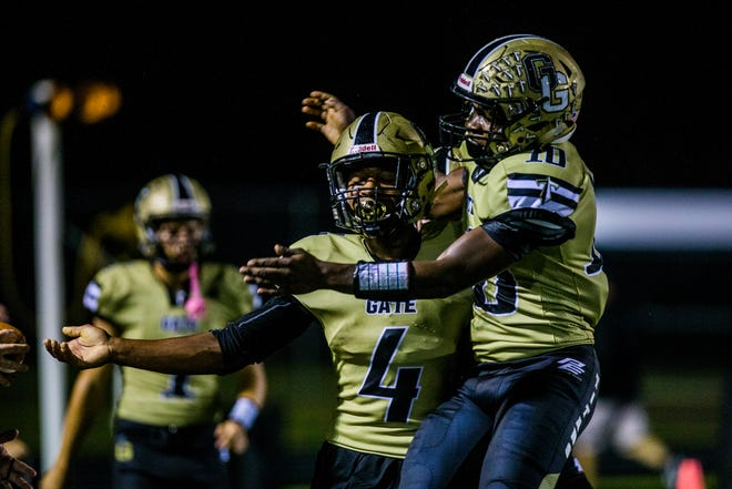 Golden Gate players celebrate a touchdown during the game against Immokalee at Golden Gate High School on Friday, Aug. 24, 2018.