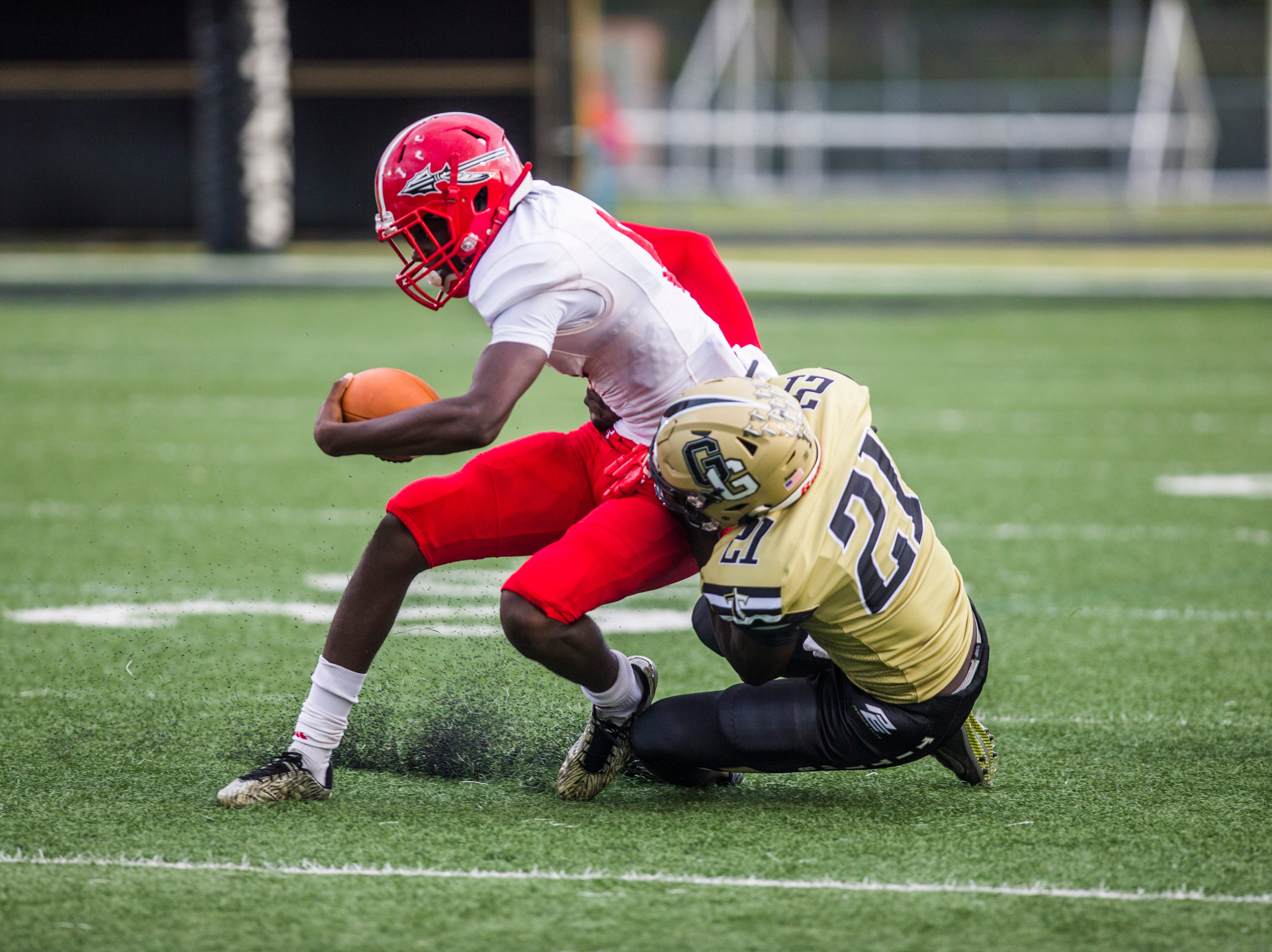 Golden Gate senior line backer Kevin Jean Jacques tackles Immokalee wide receiver Joseph Elischama during the game at Golden Gate High School on Friday, Aug. 24, 2018.