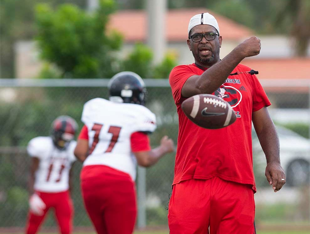 Miami-Edison head coach Luther Campbell of 2 Live Crew fame warms up his players before the game at Naples High Friday night, August 24, 2018.