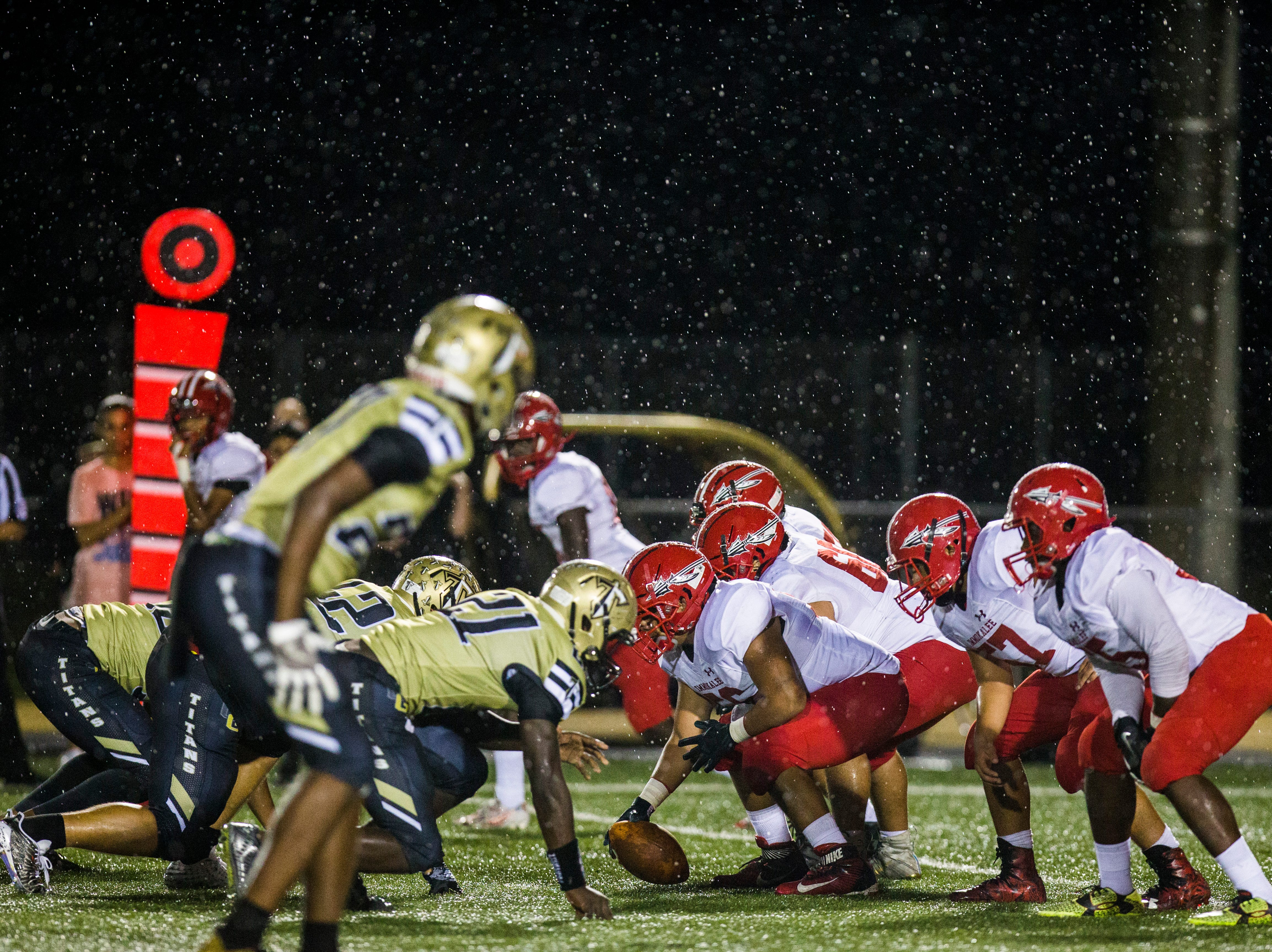 Golden Gate and Immokalee line up before a play during the game at Golden Gate High School on Friday, Aug. 24, 2018.