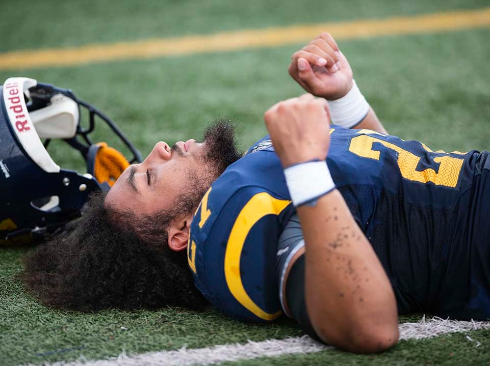 Naples running back Chez Mellusi stretches before the start of the game against Miami-Edison at Naples High Friday night, August 24, 2018.