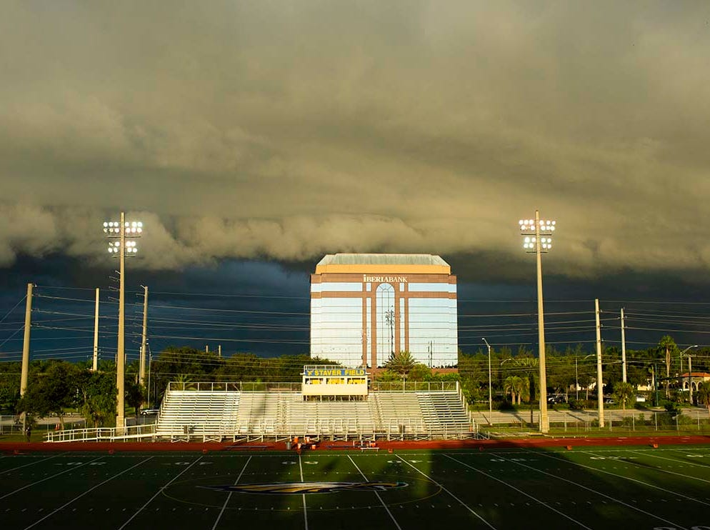 Storm clouds roll in over Staver Field for what would become more than three hour lightning delay before the game against Miami-Edison at Naples High Friday night, August 24, 2018.