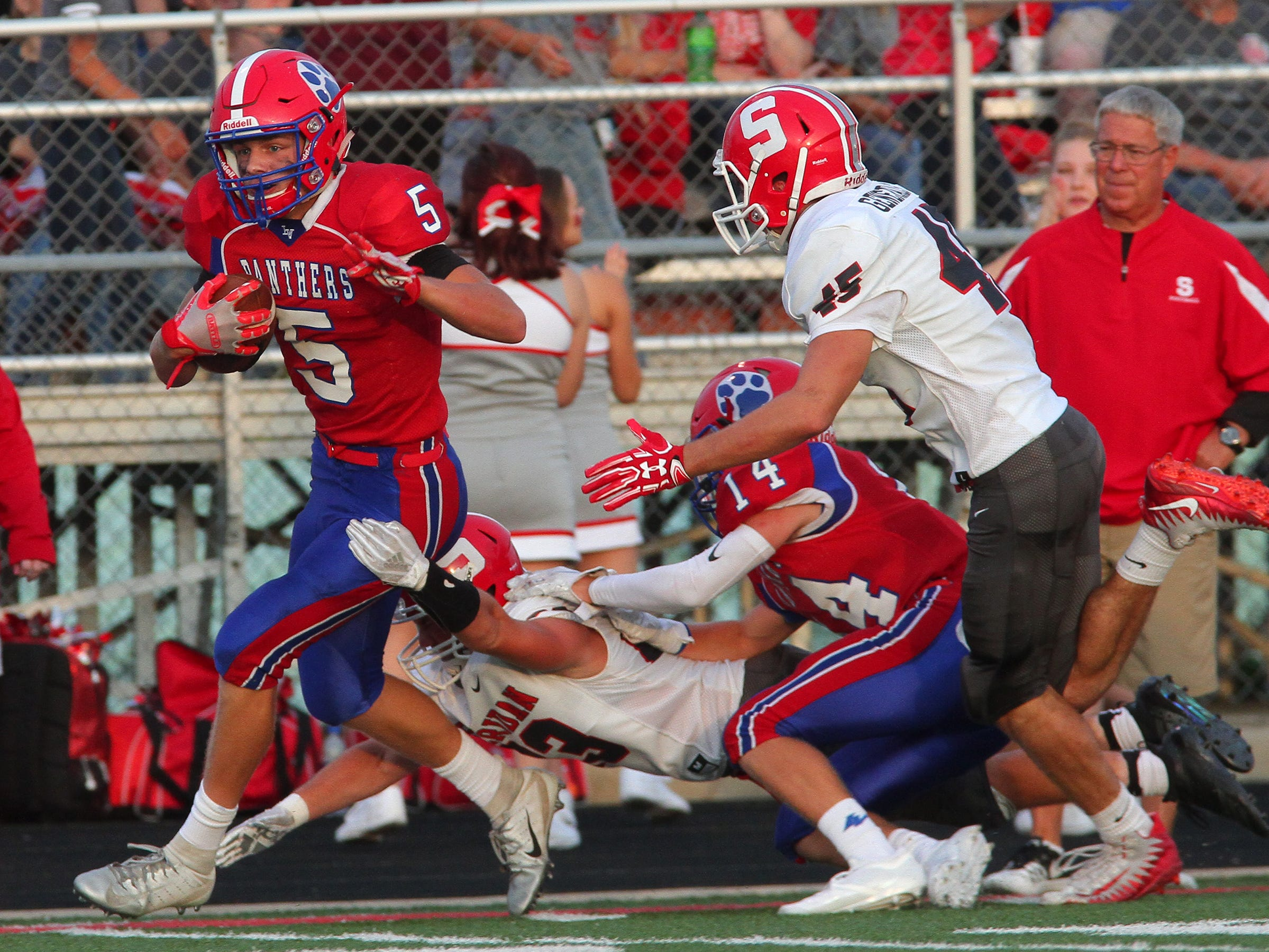 Sheridan seniors Nick Ranalli and Chance King move in on Licking Valley junior Carson Conley Friday during the Generals' 36-21 victory over the Panthers.