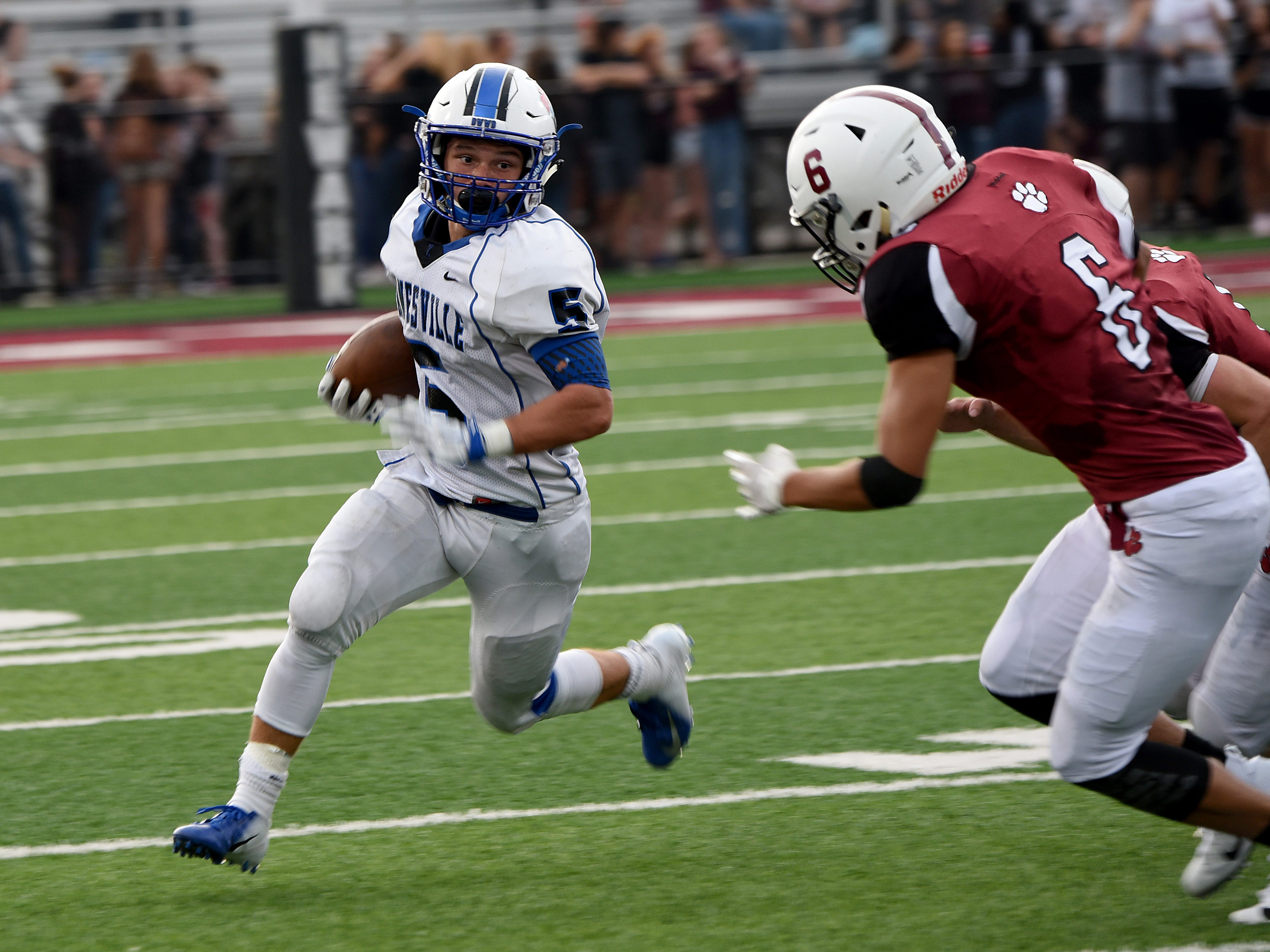J.C. Curtis runs with the ball during Zanesville's 32-27 win against rival Newark last week. The Blue Devils will host Granville on Friday night.