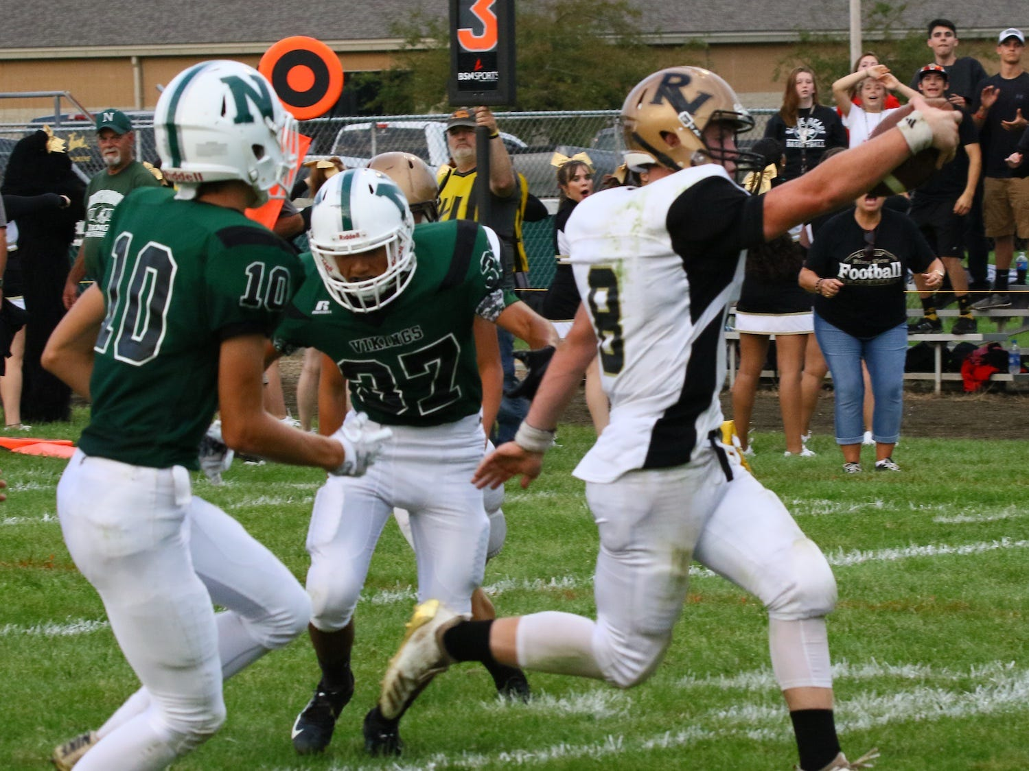 River View quarterback Gannon Unger hits pay dirt against the Vikings. The Black Bear junior led the attack against Northridge at the Vikings home stadium to start the 2018 season. River View won 30-13 on the road.