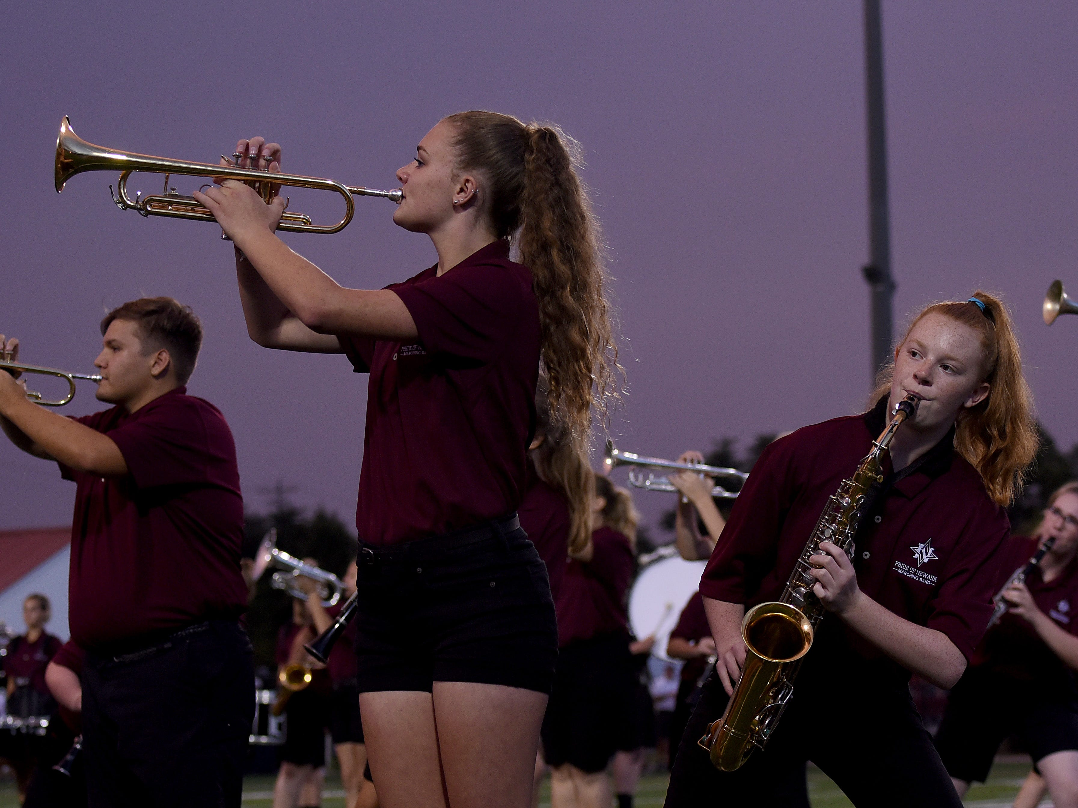 Newark High School's Trinity Harmon and Michey Orth perform with the marching band during halftime on Friday, Aug. 24, 2018.