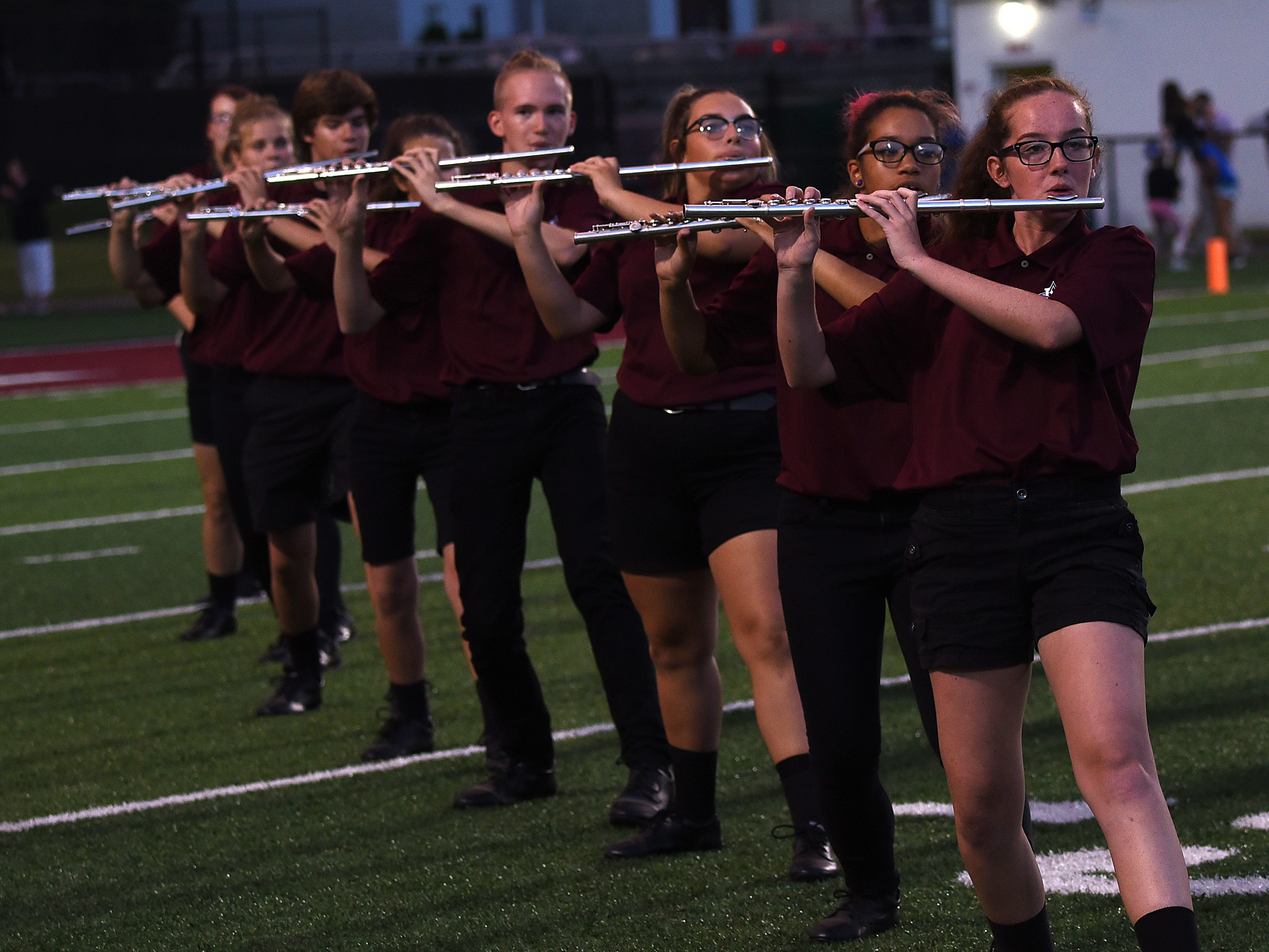 The Pride of Newark Marching Bands' flute section performs during halftime on Friday, Aug. 24, 2018.