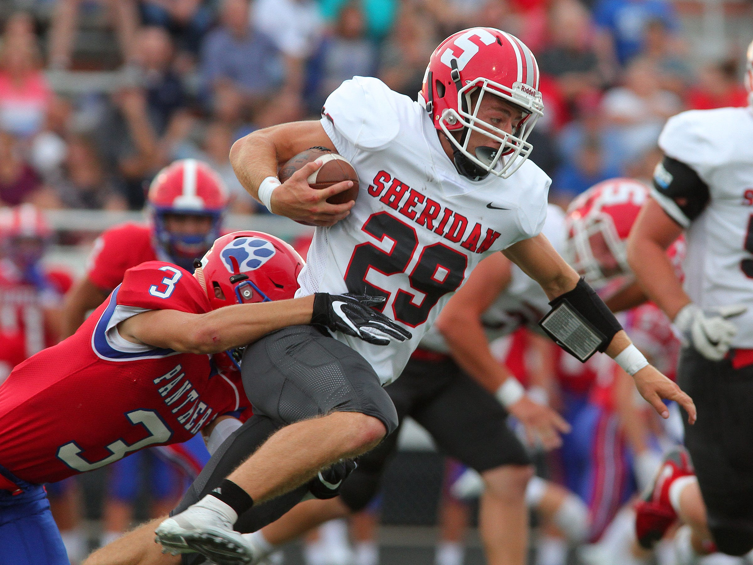 Licking Valley junior Noah Hopkins moves in on Sheridan senior Jacob Morgan carrying the ball Friday during the Generals' 36-21 victory over the Panthers.