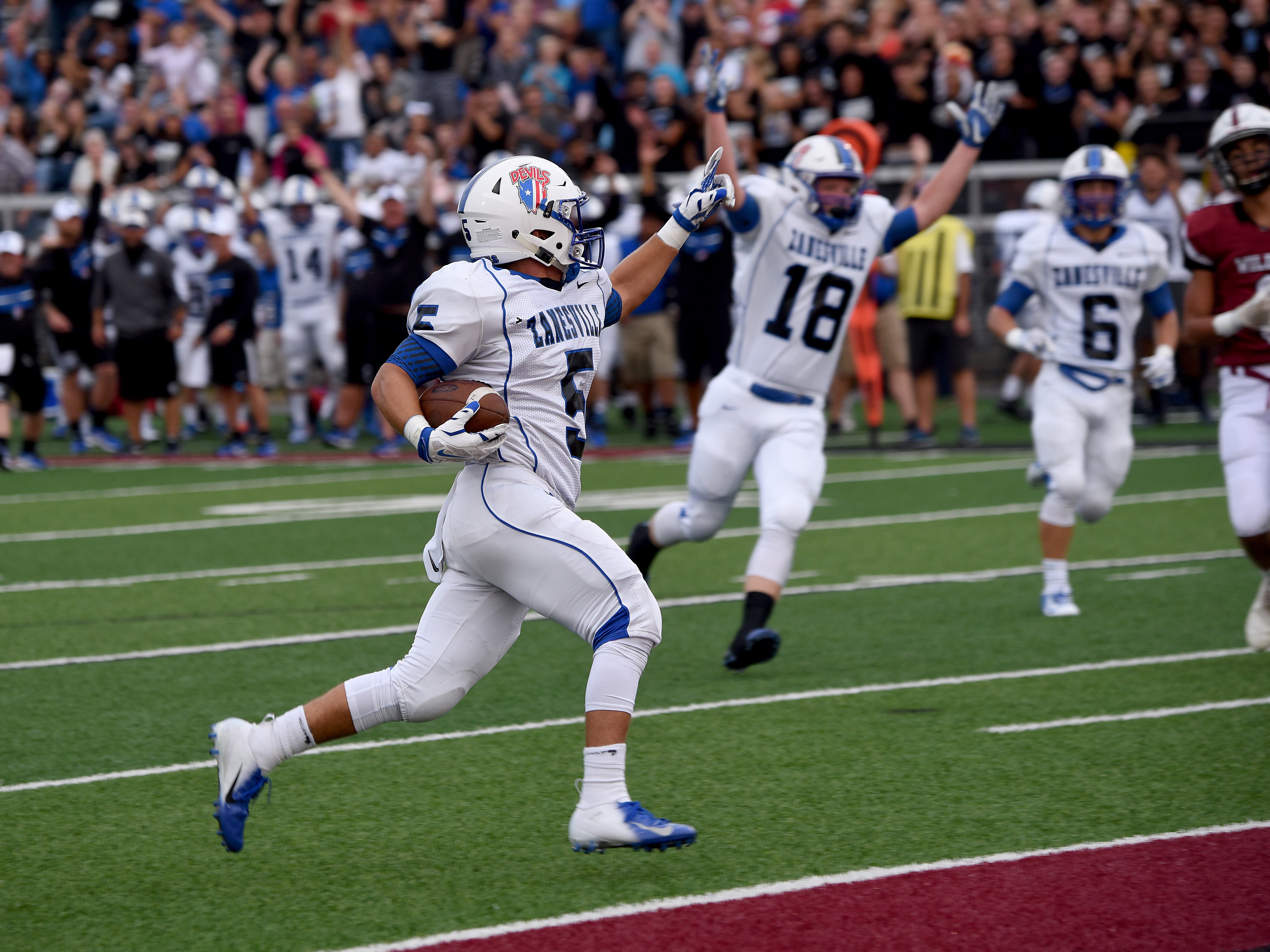 Zanesville senior running back J.C. Curtis scores the first touchdown for the Blue Devils of the 2018 season on Friday, Aug. 24, 2018 at White Field in Newark. The Blue Devils defeated the Wildcats 32-27.