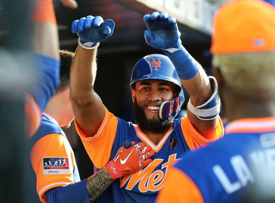 Aug 25, 2018; New York City, NY, USA; New York Mets shortstop Amed Rosario (1) is congratulated after hitting a solo home run against the Washington Nationals during the sixth inning at Citi Field.