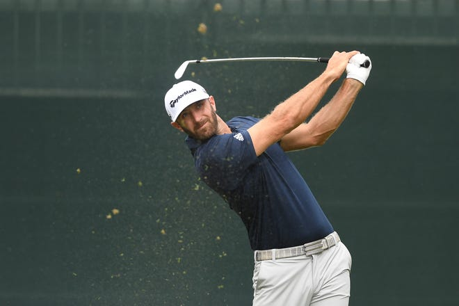 Dustin Johnson tees off from the first hole during the PGA Northern Trust at The Ridgewood Country Club on Saturday, August 25, 2018.