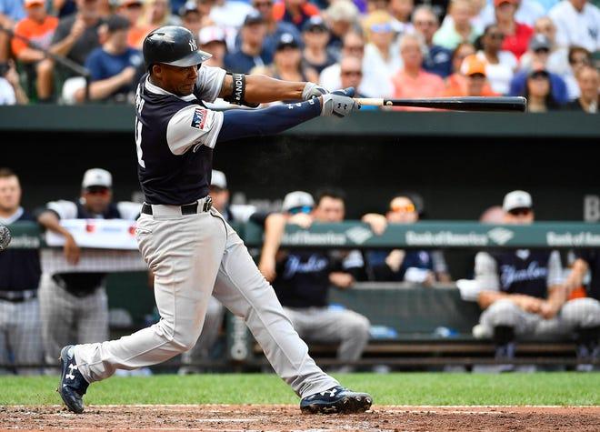 New York Yankees third baseman Miguel Andujar (41) hits a three run homer against the Baltimore Orioles during the third inning at Camden Yards.