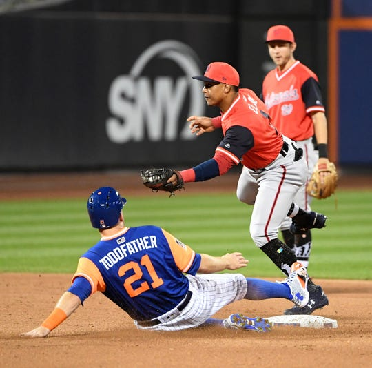 Washington Nationals second baseman Wilmer Difo forces out New York Mets' Todd Frazier at second after a liner by Austin Jackson during the sixth inning of a baseball game Friday, Aug. 24, 2018, in New York.