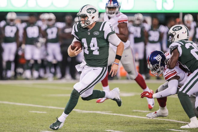 New York Jets quarterback Sam Darnold (14) rushes for yards during the first half against the New York Giants at MetLife Stadium.