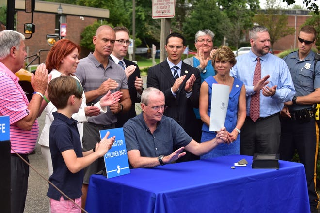 NJ Governor Phil Murphy was in Paramus to sign a law requiring new school buses to be equipped with shoulder belts as well as lap belts.
