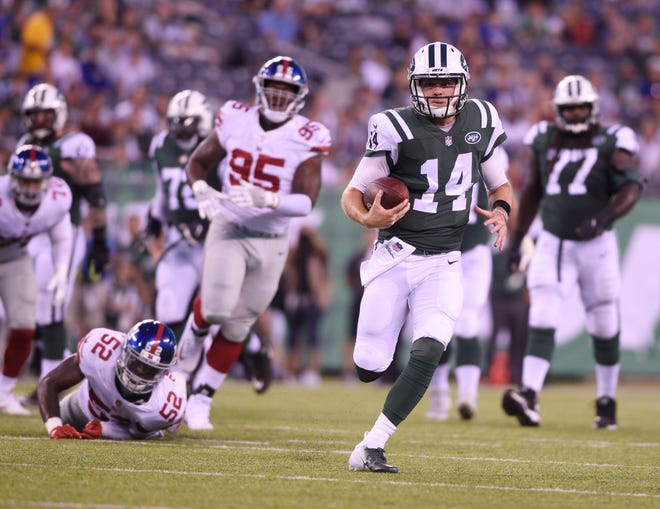 Giants vs. Jets preseason game at MetLife Stadium in East Rutherford on Friday, August 24, 2018. Jets QB Sam Darnold (14) runs with the ball in the first quarter.