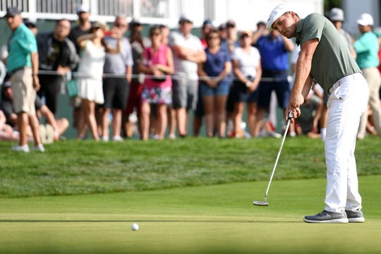 Bryson DeChambeau watches his put on the 17th green during the PGA Northern Trust at The Ridgewood Country Club on Saturday, August 25, 2018.