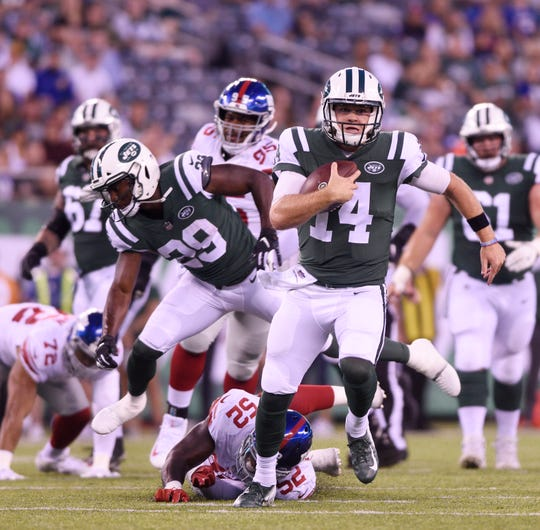 Giants vs. Jets preseason game at MetLife Stadium in East Rutherford on Friday, August 24, 2018. J #14 QB Sam Darnold runs with the ball in the first quarter.