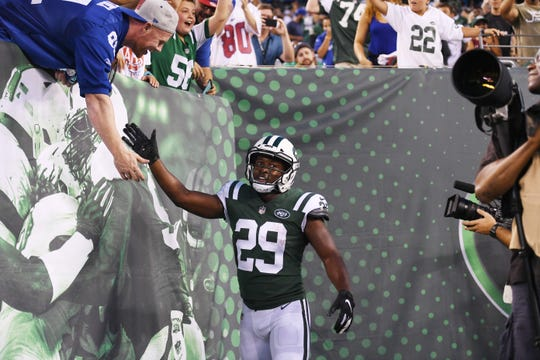 Giants vs. Jets preseason game at MetLife Stadium in East Rutherford on Friday, August 24, 2018. J #29 Bilal Powell celebrates after scoring a touchdown the first quarter.