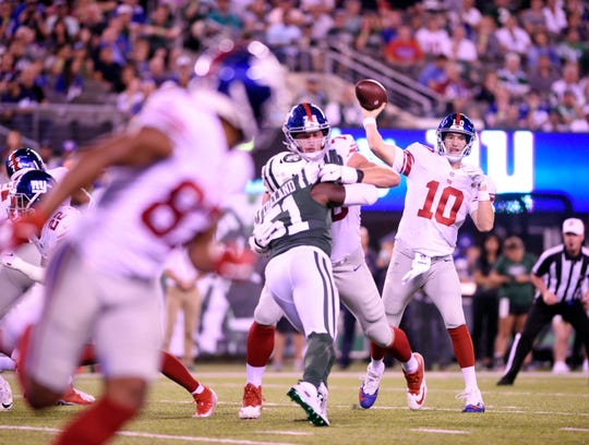 Giants vs. Jets preseason game at MetLife Stadium in East Rutherford on Friday, August 24, 2018. G #10 Eli Manning throws in the second quarter.
