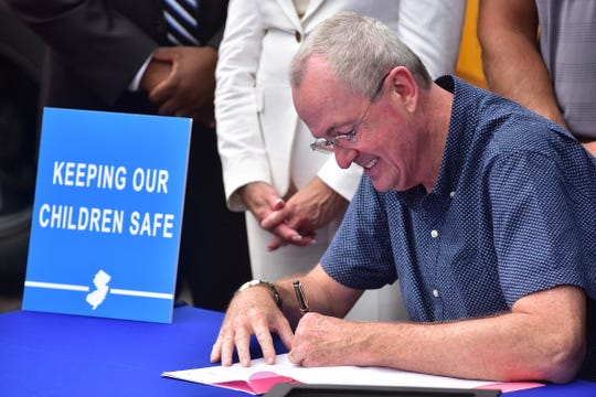 NJ Governor Phil Murphy signs School Bus Safety Bill in Paramus, NJ.