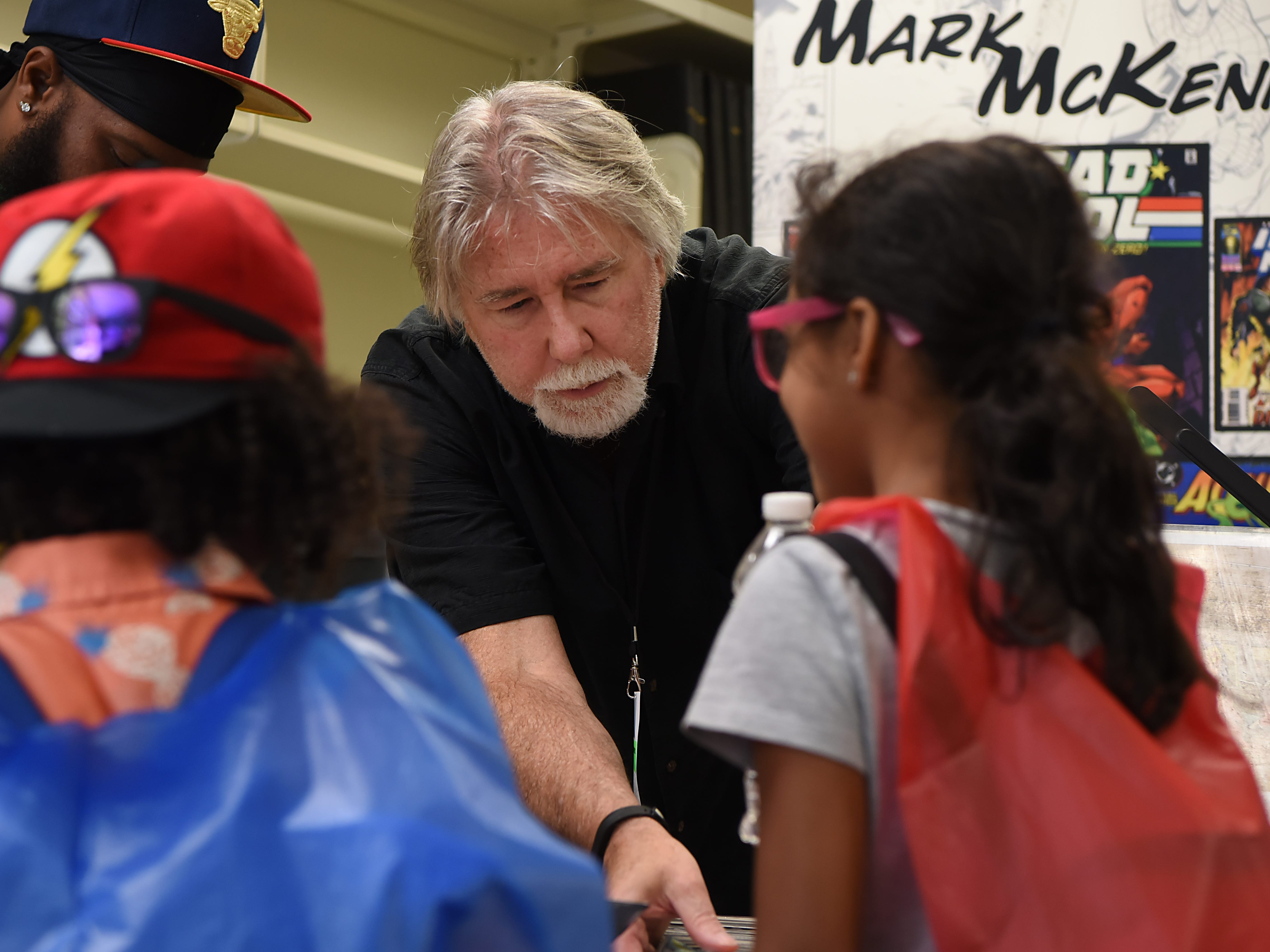 Mark McKenna, comic book artist, with some young fans during Comic-Con at Bergenfield Public Library in Bergenfield on Saturday August 25, 2018.