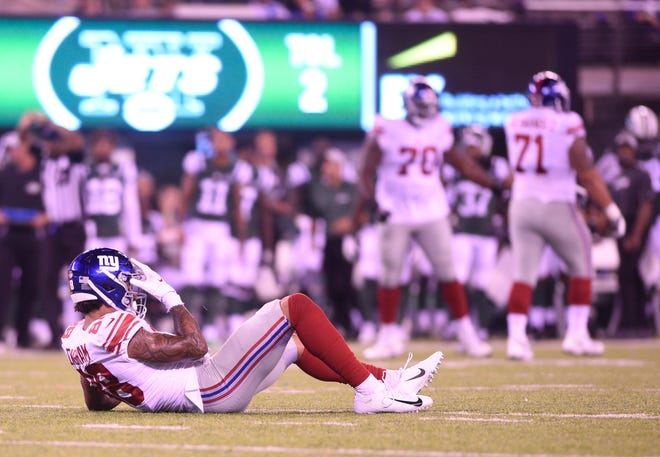 Giants vs. Jets preseason game at MetLife Stadium in East Rutherford on Friday, August 24, 2018. G #88 Evan Engram after getting tackled in the second quarter.
