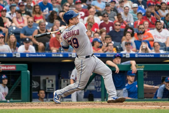 Aug 18, 2018; Philadelphia, PA, USA; New York Mets catcher Devin Mesoraco (29) hits a home run during the seventh inning of the game against the Philadelphia Philliesat Citizens Bank Park.