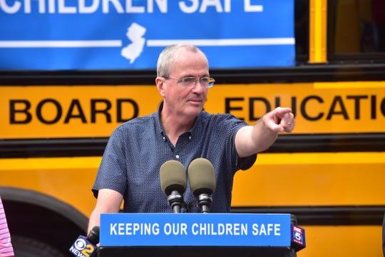 NJ Governor Phil Murphy signs School Bus Safety Bill in Paramus, NJ.